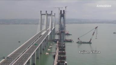 Main tower capped for sea-crossing bridge in Fujian, China